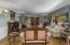 Your living room has Australian Cyprus hardwood, crown molding and batten wood wall paneling.