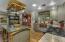 You have custom cabinetry with natural wood and painted cabinetry. You also have a copper, single bowl, farmhouse sink.