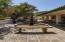 Your front courtyard is tranquil and has built in seating as well as a fountain.