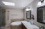 Jacuzzi tub, walk in shower, double sinks and walk -in closet