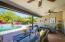 Lovely extended patio with views of the sparkling pool and spa