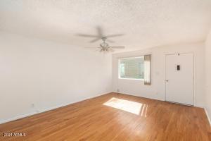 Living room. Nice laminate wood flooring throughout.