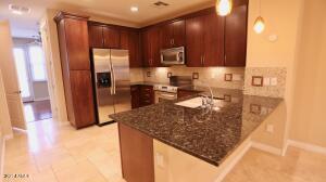 Gourmet Kitchen with Granite Slab countertops and full mosaic backsplash