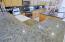 Raised level granite tiled countertops