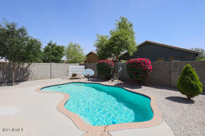 Sparkling pool with Basketball hoop and tons of extended concrete for entertaining