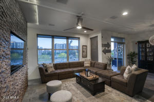 Big, open living space and large windows that show city lights!