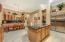 Kitchen with Granite Counters, Stainless Appliances, Built-In Refrigerator and Maple Cabinets