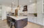 Large island with Quartz countertops and seating for four