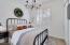 Cozy farmhouse-style guest room
