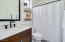 Marble-top vanity with farmhouse shiplap wall treatment