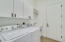 Clean and bright laundry room with garage access