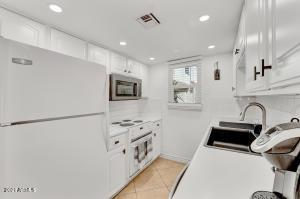 This bright white kitchen is full of updated appliances and plenty of storage space.