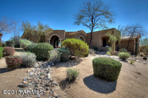 Highly upgraded, Edmunds Cimarron floor plan, semi-custom home on the 1st fairway of DC Ranch Country Club