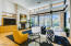 12 foot glass sliding doors open to covered patio for indoor/outdoor entertaining