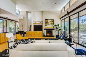 Open Family Room with Soaring Ceilings and Expansive Windows