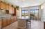 Kitchen features oversized windows that overlook the 7th hole of the Country Club at DC Ranch.