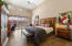 Master suite features beautiful wood-like tile flooring and a private patio lined with flowering hedge.