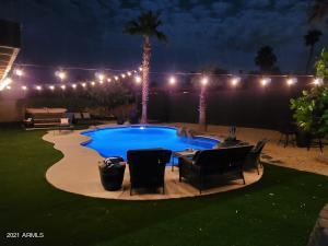 Resort backyard, hot tub and pool lights