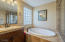 Glass block wall and tile surround