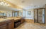 Pamper yourself in this relaxing master retreat with double sinks, vanity and mirrored doors
