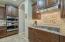 Double ovens and upgraded backsplash with mosaic design