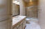 This is the bathroom off the kitchen and the pool. Perfect for guests or as a wet room.