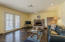 Opens to kitchen to form large great room feel French doors lead to rear covered patio