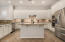Spectacular kitchen with generous counter space, island and breakfast bar