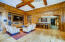 Gorgeous wood plank floor and wood paneled walls in resident's lounge
