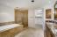Granite, two vanities, separate tub, walk in shower, large walk-in closet