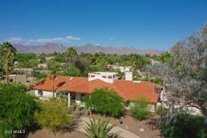 Welcome home to your captivating 4+ bedroom single level Von Dix custom home conveniently located in cactus corridor.