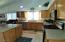 Kitchen has quartz countertops, stainless steel appliances, a pantry, and an island. Refrigerator is INCLUDED!