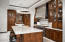 CUSTOM DESIGNED KITCHEN WITH OVERSIZED ISLAND WITH DINING