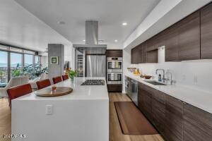 kitchen with large wine fridge and views of the city and mountains