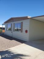 Welcome Home! Drive right up to your shaded Carport.