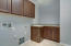 with granite counters and utility sink!