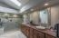 Bright and spacious master bath. New cabinetry, counter tops and custom walk in shower