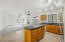 Kitchen with Granite Tile Counters and Stainless Steel Appliances.