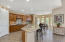 Incredible open kitchen space with breakfast bar and bay area dining space