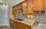 Maple cabinetry, rich backsplash and granite counter tops!