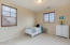 Bedroom 3 opens to Juliet balcony to right with neutral tones and great space!