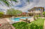 WOW! Stunning backyard with easy care and blissful enjoyment. Sparkling pool, faux year round green grass, soothing fountain bubblers for soothing sounds