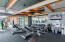 Generous equipment in workout facility with spa, yoga, lap pool and so much more!