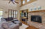 Open living room with gorgeous stack stone fireplace and entertainment niches
