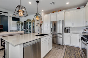 Gourmet kitchen with Quartz countertops and upgraded appliances