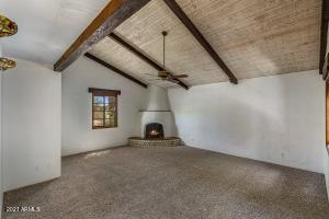 Your living room has a beehive fireplace, vaulted ceilings, and gorgeuous beams.