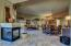 3-way gas fireplace overlooks great room, family room & kitchen