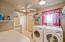 Laundry Room with access to backyard/pool area