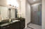 Guest bathroom with private entry.