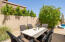 There is also a huge side yard space with additional dining space!